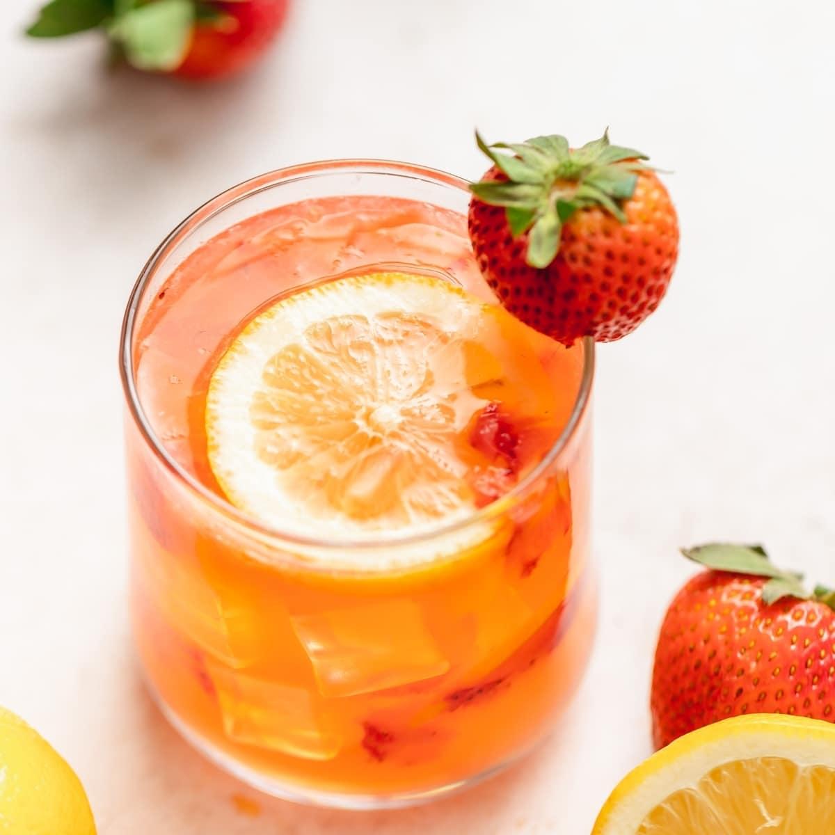 boozy strawberry lemonade with fresh strawberries