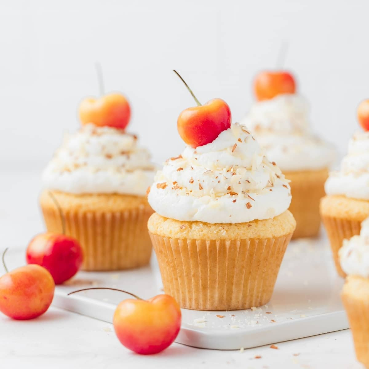 rainier cherry and almond cupcakes with cherries on top
