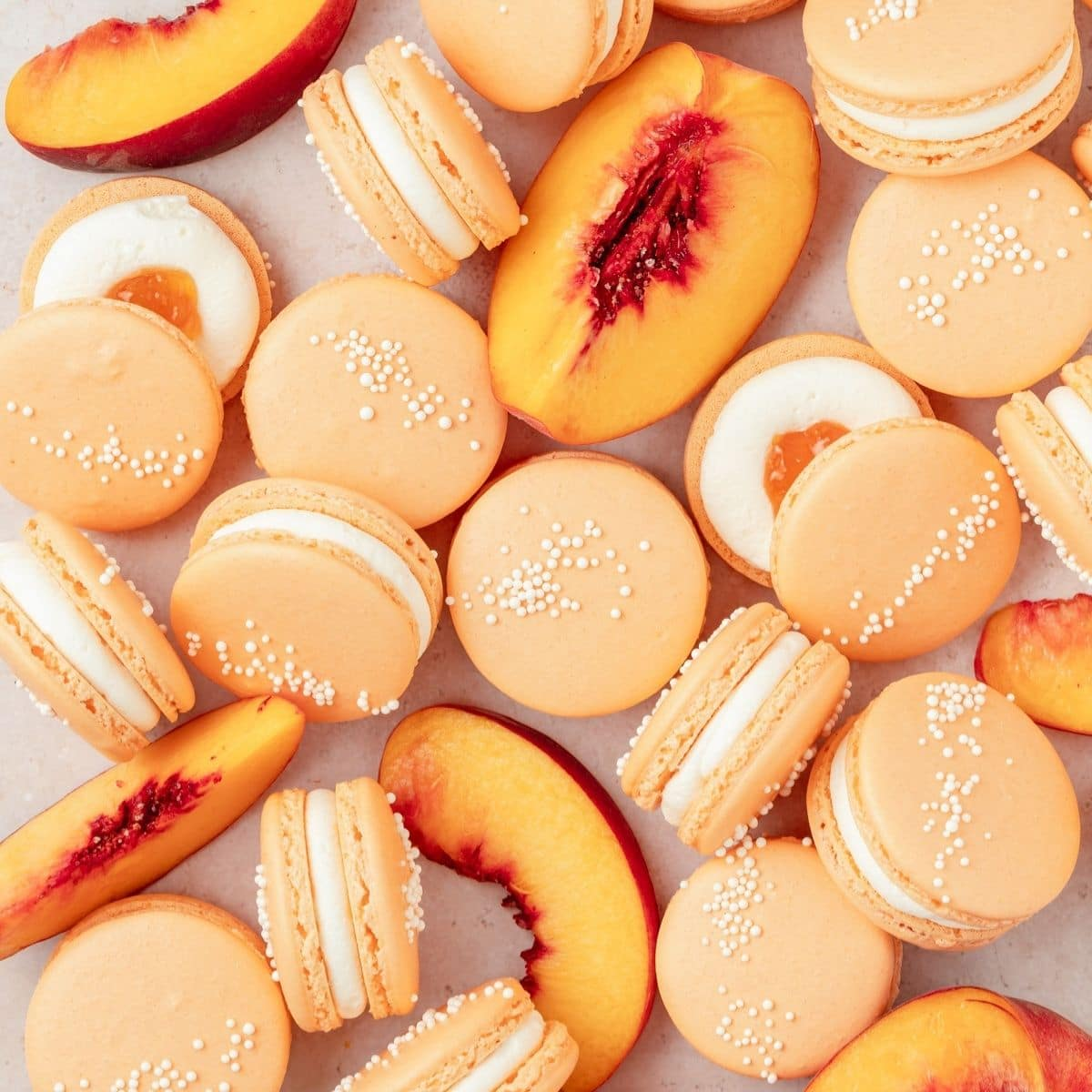 close up shot of peach macarons with whipped cream